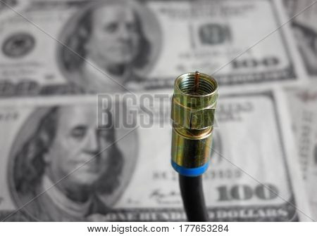 Coax cable closeup with money in the background