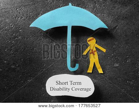 bandaged paper man under umbrella with Short Term Disability Coverage note below