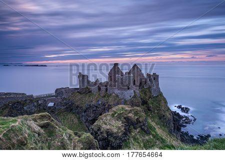 Sunset at Dunluce Castle on the north coast of Ireland