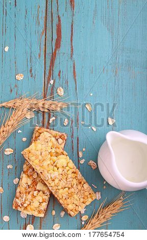 healthy snack muesli bars with raisins and nuts on a blue background