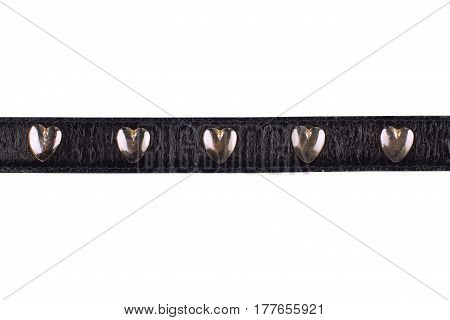 detail of female black leather belt with chrome heart shaped decoration isolated on white background