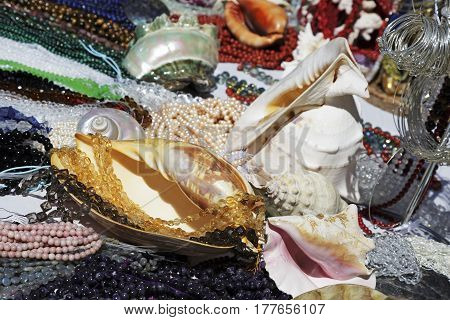 Nice France - May 17 2014: Various stuff on sale during the flea market which was held on one of the squares in the city. On the table a lot of shells and variety of beads can be seen
