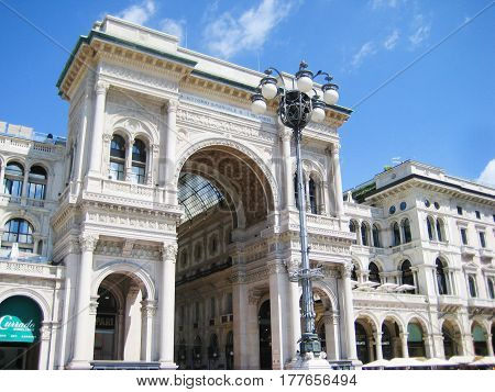 MILAN, ITALY - AUGUST 12, 2016: Victor Emmanuel Gallery in Milan, Lombardy province, Italy (Galleria Vittorio Emanuele II). High-priced shopping mall in downtown Milano, european shopping capital. Front entrance arch
