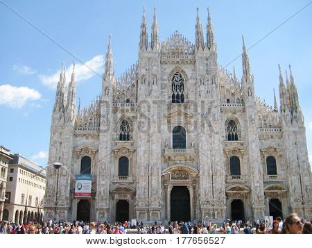 MILAN, ITALY - AUGUST 12, 2016: People in front of Piazza Duomo di Milano cathedral in Milan, Italy. Popular travel landmark in Europe.