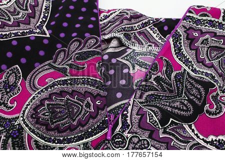 A purple zipper in a homemade patterned skirt