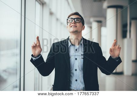 Businessman Pointing Up In Office Hall