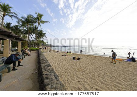 HONOLULU, USA - FEBRUARY 15, 2017: Stock photo of a beach scene on Waikiki Beach Oahu Hawaii