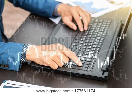 Business Trading Concept : Man Trade Stock And Forex By Laptop And Analysis