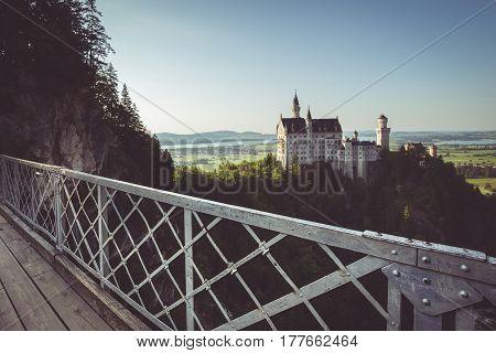 Neuschwanstein Castle With Marienbrucke Bridge At Sunset, Bavaria, Germany