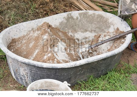 Mixing a cement in salver for applying construction.