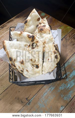 naan eastern type bread in basket fresh baked