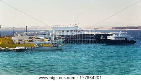 Tourist yachts and boats near the pier in Hurghada. Egypt..