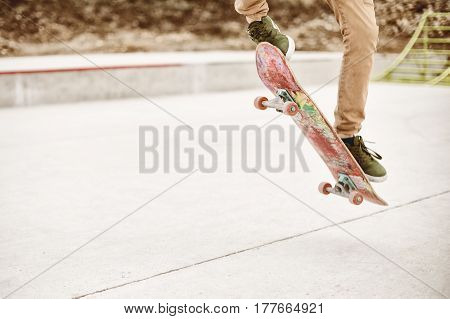 Close-up of skateboarder foot while skating in skate park