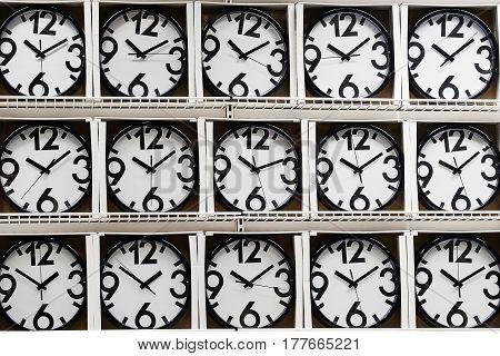 the same wall clocks hanging on the wall