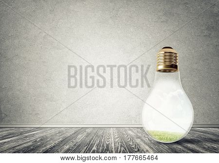 Glass light bulb in concrete empty room. Eco concept