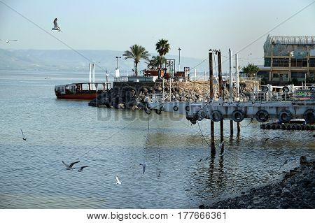 TIBERIAS ISRAEL - FEBRUARY 26 2017: Jetty on the Tiberias promenade on Lake Kinneret