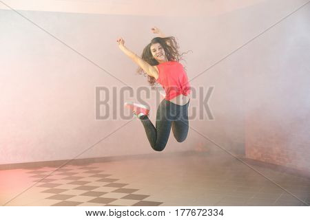 Beautiful young hip-hop dancer in studio