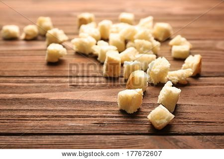 Croutons of wheaten bread on wooden background