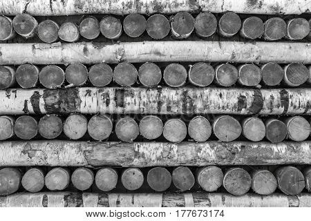natural background and old texture of wooden logs and firewood