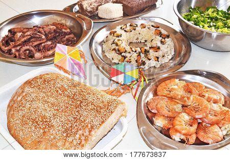 Clean Monday food - lagana bread - seafood - greek halvah and decorative kites