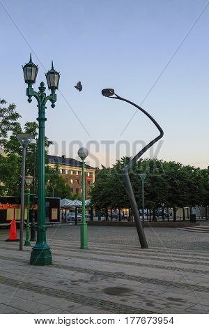HELSINGBORG, SWEDEN - JUNE 28, 2016: There are five different lanterns on a small city square.