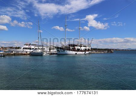 VODICE, CROATIA - SEPTEMBER 6, 2016: There are a marine pleasure crafts in the port of small Croatian town.