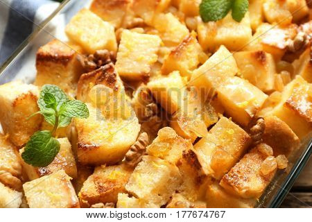 Delicious bread pudding with raisins and mint, closeup