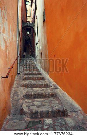 Narrow street of an old European city. Roussillon. France.