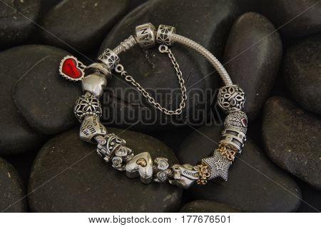 Pandora Bracelet, on black stones. Photo by Ron Hartwell