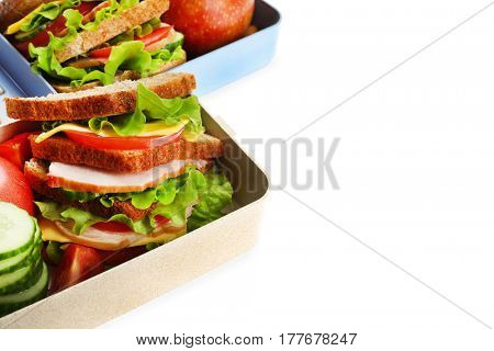 Lunch boxes with delicious food on white background