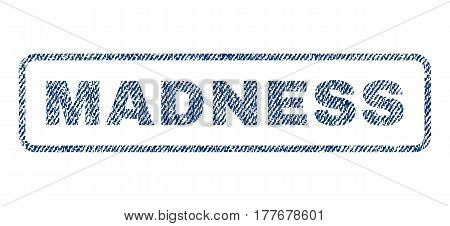 Madness text textile seal stamp watermark. Blue jeans fabric vectorized texture. Vector tag inside rounded rectangular shape. Rubber sign with fiber textile structure.