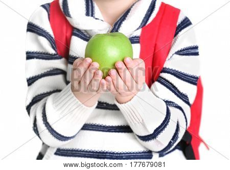 Cute little schoolboy with apple on white background, closeup