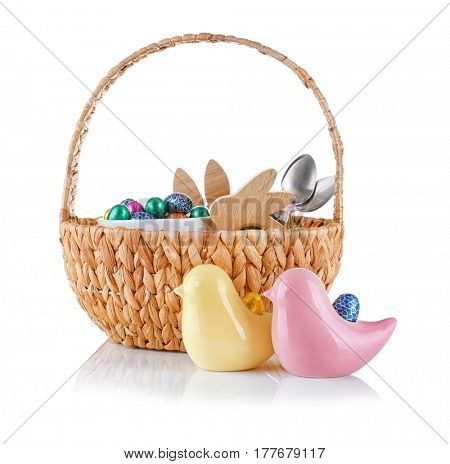 Easter basket with eggs and gifts on white background