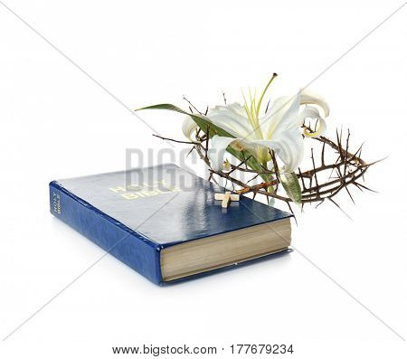 Holy Bible, crown of thorns and Easter white lily on white background