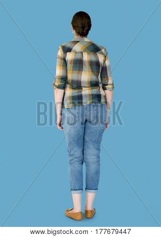 Woman casual standing in rear view studio portrait