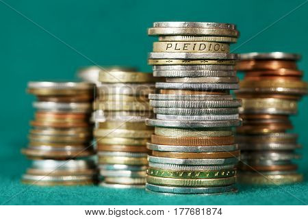 Coins stacked in piles are visible on a green background