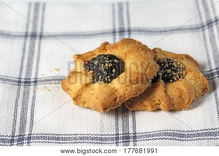 Cookies with fruit jam placed on the fabric