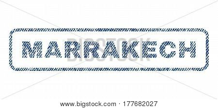 Marrakech text textile seal stamp watermark. Blue jeans fabric vectorized texture. Vector caption inside rounded rectangular shape. Rubber sign with fiber textile structure.