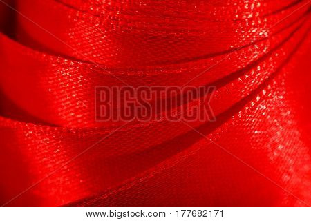 Decorative red ribbon falls down from the roll