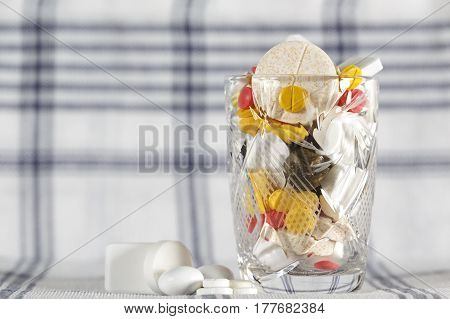 Overdose of medicines is excessive number of pills and this has been shown in a glass filled to the brim