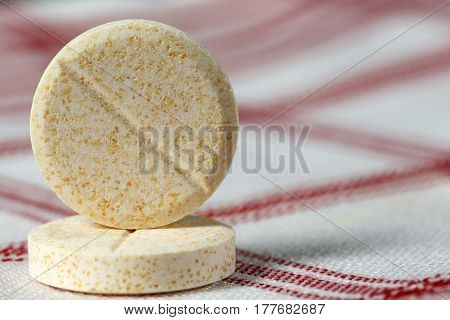 Two pills have been arranged on the fabric