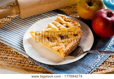 home made apple tart on a white plate
