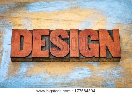 design word typography - text in vintage letterpress wood type blocks against grunge wooden background