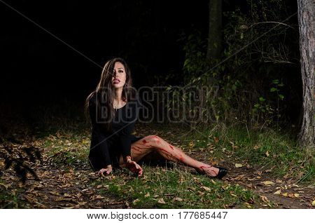 Woman Halloween Girl With Blood In The Forest At Night