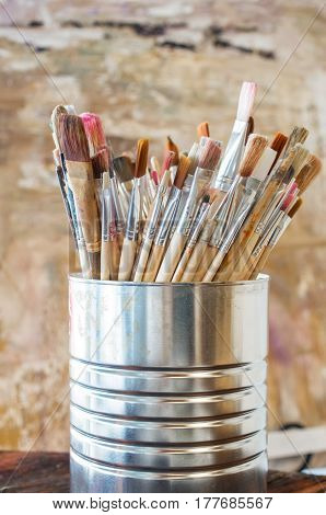 Artist Paint Brushes. Used kit paint brushes in can. Close-up.