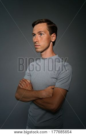 Portrait of caucasian man standing with hands crossed over gray background.