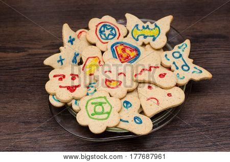 Cookies with a random superheroes biscuits .