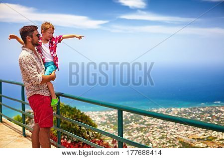 Happy Father And Son Enjoying The Fascinating View On Atlantic Ocean Coastline From Observation Deck