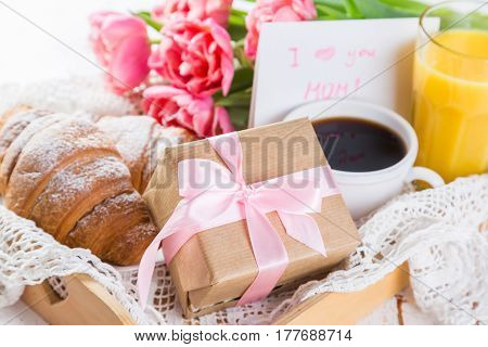 Mother's day card with coffee, present, copy space