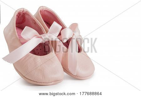 Pair Of Pink Ballet Shoes With Bowknot For Newborn Baby. Isolated On A White Background Close Up.